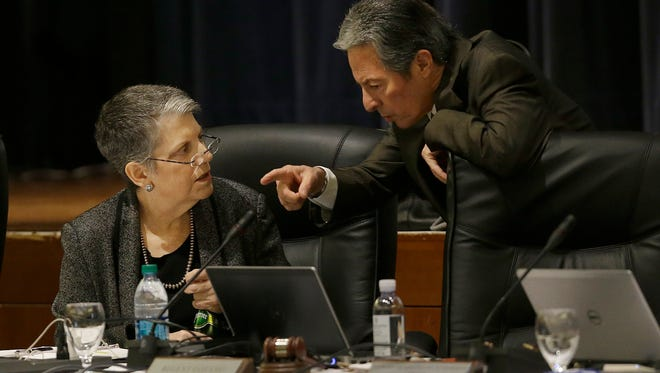 University of California president Janet Napolitano, left, talks with regent Hadi Makarechian at a Board of Regents meeting in San Francisco on Thursday. The university system's regents voted Thursday for a plan to increase tuition by 2.5 percent a year, its first tuition increase in seven years.