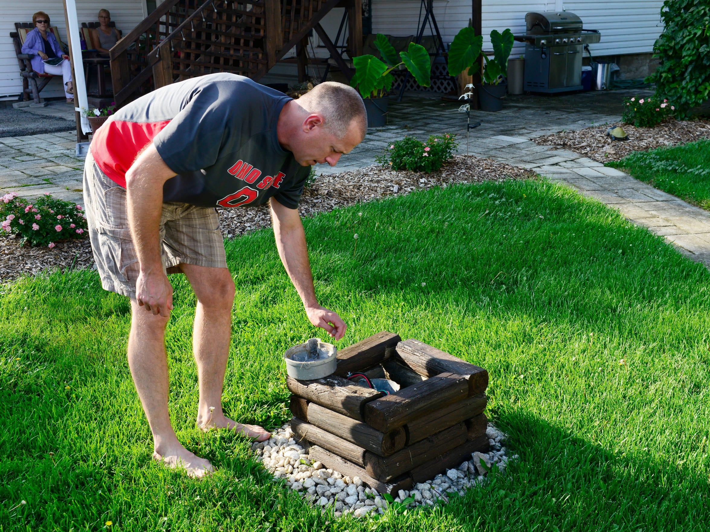 Rich Herrig draws water from a well in his backyard in Benton Township. He does not drink the water, saying he his concerned over contaminants from the residual sludge being dumped at the nearby Rocky Ridge Development LLC quarry.