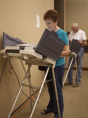 Arvonne Whittaker and her husband Dee Whittaker vote at the Washington City Library Tuesday, Aug. 11, 2015.