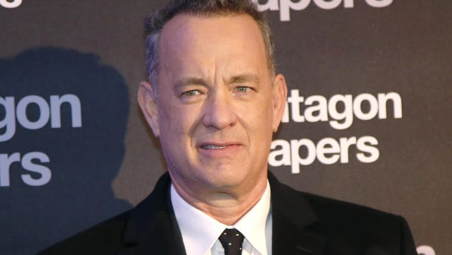 In this Jan. 13, 2018, file photo, Actor Tom Hanks poses for photographers on arrival at the French premiere of the film 'The Post' in Paris. Hanks recently surprised a New Mexico woman celebrating her birthday at an Albuquerque, N.M., restaurant by singing 'Happy Birthday' to her.
