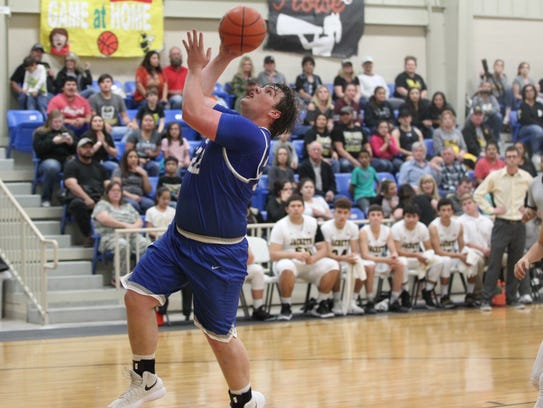 Eden High School's Nate Hernandez scored nine points in Friday's 93-55 area playoff win against Roby.