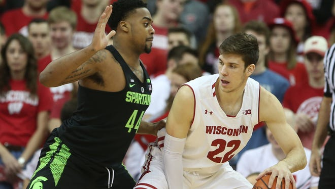Wisconsin Badgers forward Ethan Happ (22) dribbles the ball as Michigan State Spartans forward Nick Ward (44) defends during the first half at the Kohl Center. Feb 25, 2018; Madison, WI.