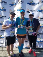 From left, Lisa Blackhurst, Jill Hazelton and Nichole Kunkle pose for a photo after completing last weekend's Key West Half Marathon. Hazelton highlighted Franklin County runners by finishing in 1:39:26 to finish third in the 40-44 age group and as the 14th female overall.