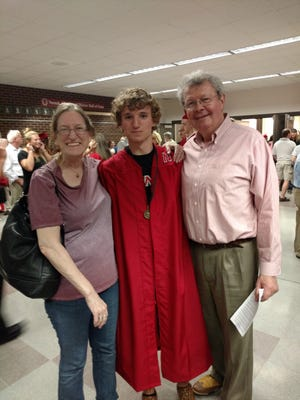 Alex Melchert is seen with his parents, Ken and Rebecca, at Neenah High School's graduation in the spring. He was shot six times at an Ohio rest stop Sunday.