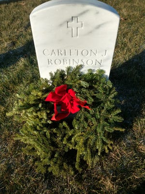The grave of Port Huron native Col. Carleton Robinson received a wreath.