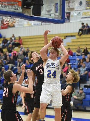 Mountain Home's Luke Dibble (24) is fouled during the Bombers' 56-54 victory over Russellville on Friday night at The Hangar.