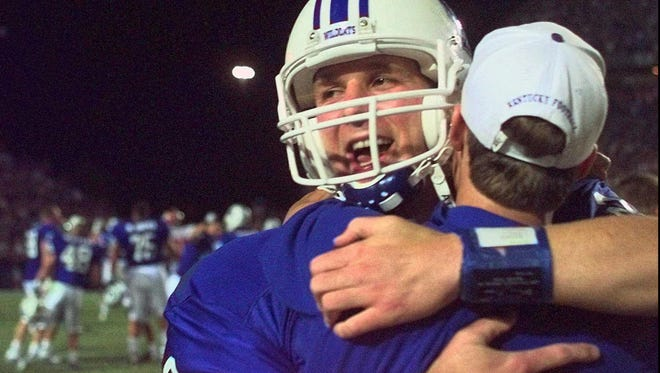 Kentucky quarterback Tim Couch is hugged after his team won a 40-34 overtime thriller over SEC rival Alabama Saturday night, Oct. 4, 1997, in Lexington, Ky. Couch threw for 355 yards in the game, including a 26-yard completion to teammate Craig Yeast for the win. (AP Photo/Ed Reinke)