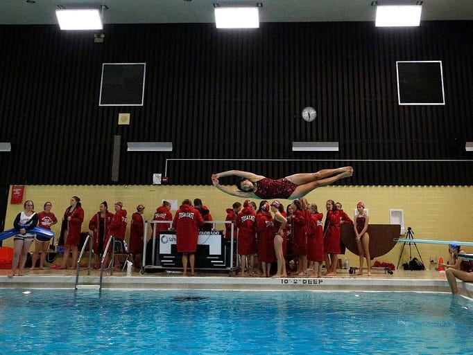Wauwatosa East Diver Amaya Ibanez-Balder warms up before