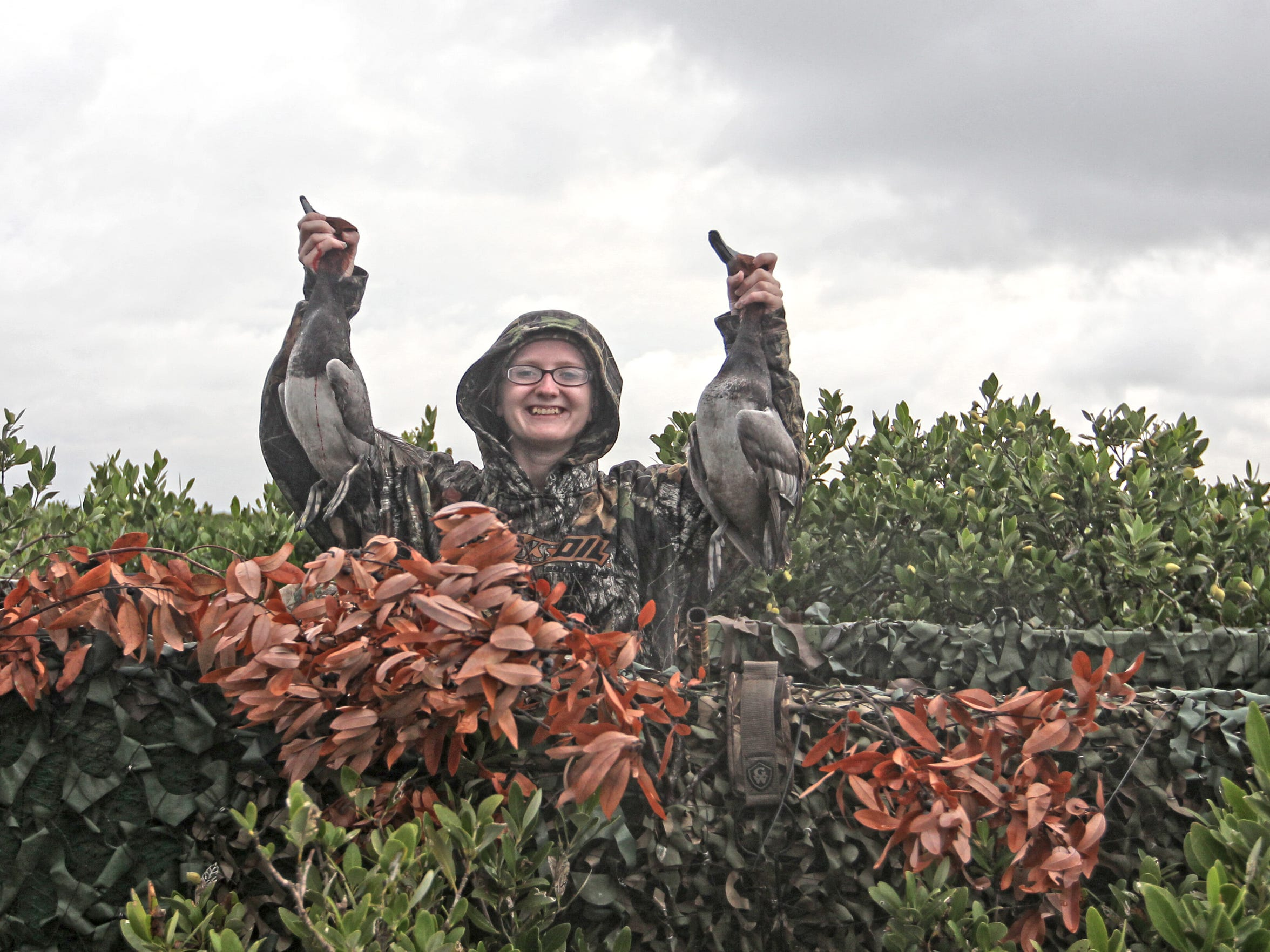 A women near Rockport proudly displays the ducks her party bagged during the early 2017 season.