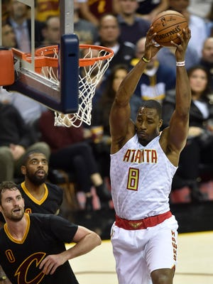 Atlanta Hawks center Dwight Howard (8) reaches for a rebound in front of Cleveland Cavaliers forward Kevin Love (0) in the second quarter at Quicken Loans Arena.