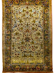 During an August auction, this Persian Quam Tree of Life picture rug sold for $1,800