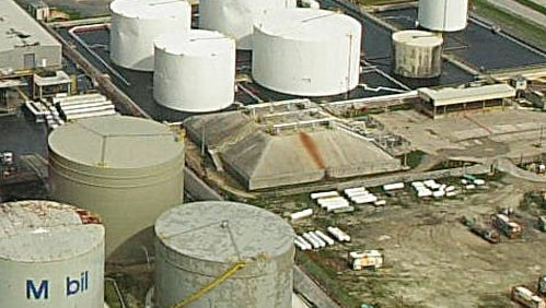 This file photos shows fuel tanks at the commercial port at Cabras Island.