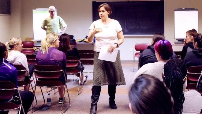 WNMU Counselor Sarah Guck, center, discusses rape prevention while author Todd Denny, at left, looks on. The sexual assault awareness workshops will continue on Feb. 2 and Feb. 9.