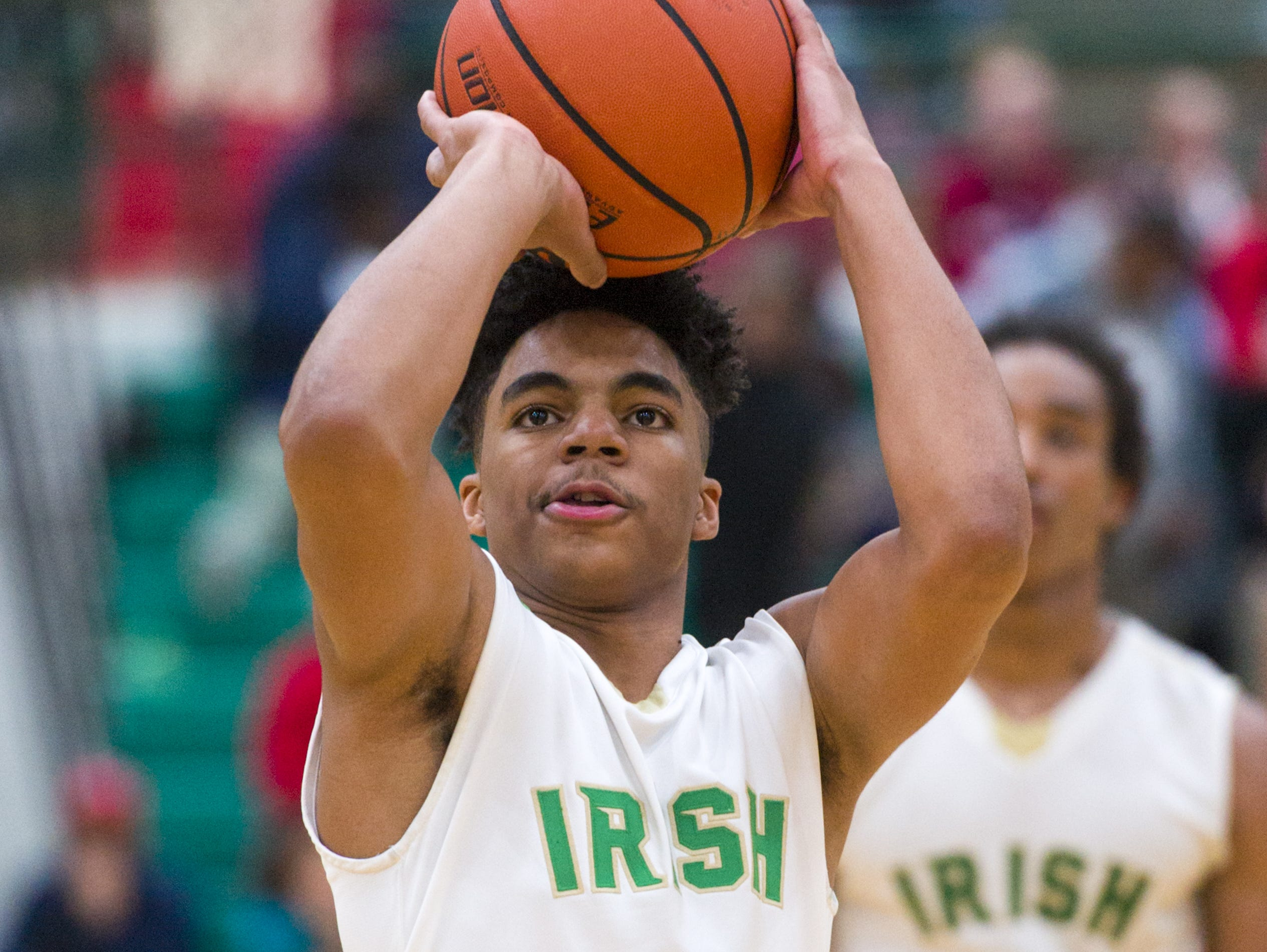 Cathedral High School sophomore James Franklin (0) shoots a free throw during the second half of the Indianapolis City Boy's Basketball Tournament championship game Monday, Jan. 23, 2017, at Arsenal Tech High School. Cathedral won 91-67.