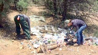 Silver City Ranger District employees work on removing trash and debris from the Bear Mountain area.