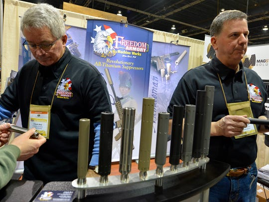 Chuck Betz, left, and Scott Morris from Freedom Armory in Glen Rock show their firearm suppressors to guests at the Great American Outdoor Show at the PA Farm Show Complex, Sunday, Feb. 4, 2018. John A. Pavoncello photo