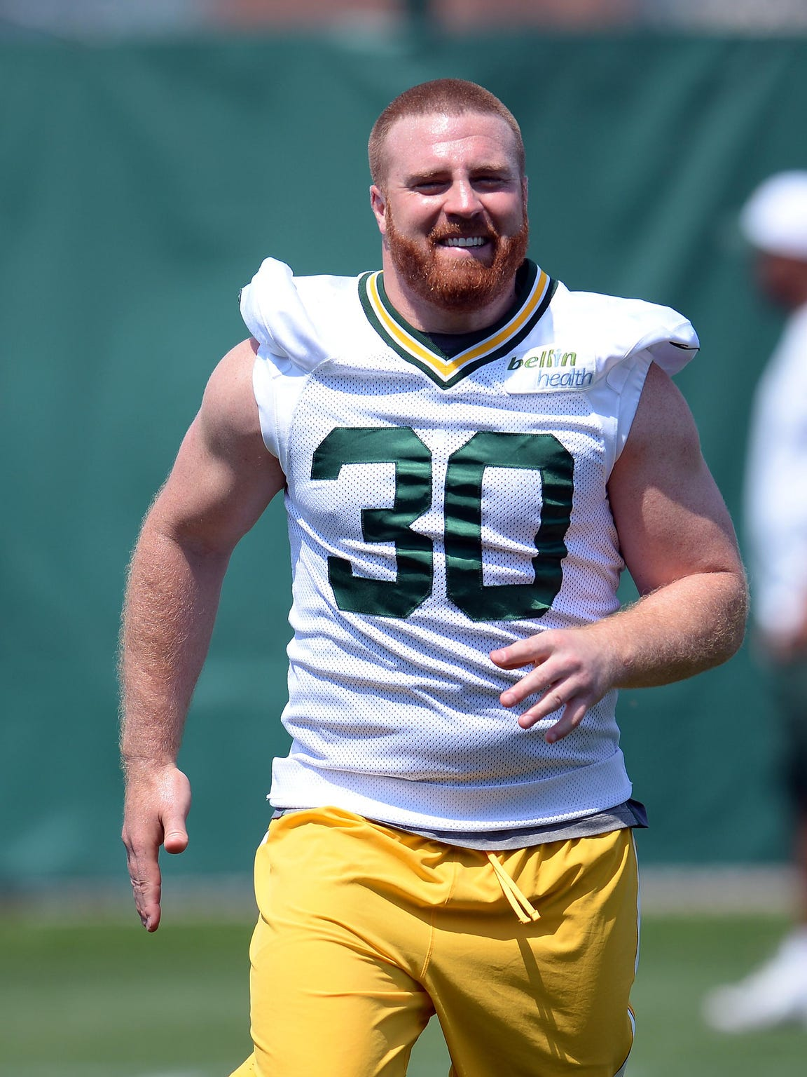 Green Bay Packers fullback John Kuhn smiles during