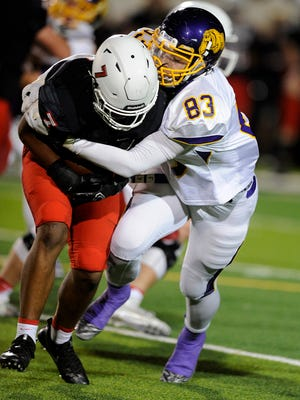 Wylie defensive lineman Ryan Hamar (83) tackles Argyle running back Don Williams (7) for a loss during the second quarter of the Bulldogs' 35-14 win in the Region I-4A Div. I semifinal playoff on Friday, Nov. 25, 2016, at Ram Stadium in Mineral Wells.