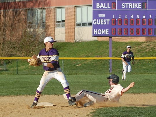 Cherry Hill West second baseman Michael Wurster fires to first after getting the force out on a sliding Jordan Brandt of Eastern in the eighth inning Monday.