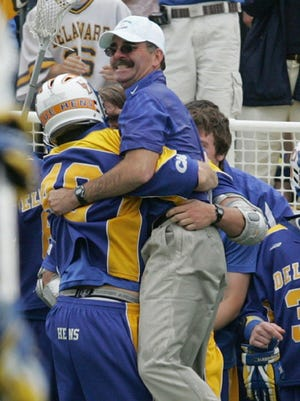 Coach Bob Shillinglaw is lifted up by Curtis Dickson at the end of the game as Delaware beats UMBC 10-6 in the 2007 NCAA quarterfinals at Navy Marine Corps  Memorial Stadium.