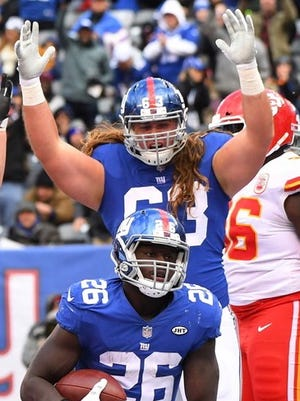 Giants rookie right tackle Chad Wheeler celebrates Orleans Darkwa's touchdown run in Sunday's 12-9 overtime victory over the Kansas City Chiefs at MetLife Stadium in East Rutherford. Wheeler made his first NFL start in that game, and now he looks to build on that success on Thanksgiving Night against the Washington Redskins in Landover, Md.