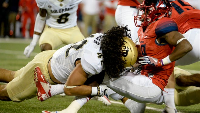 Arizona Wildcats cornerback DaVonte' Neal (19) is tackled by Colorado Buffaloes linebacker N.J. Falo (42) during the second quarter at Arizona Stadium, Nov. 12, 2016, in Tucson.