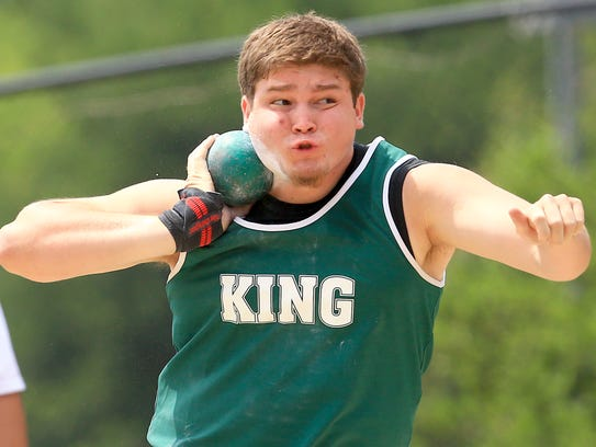 King's Robert Gonzalez throws the shot put as he competes