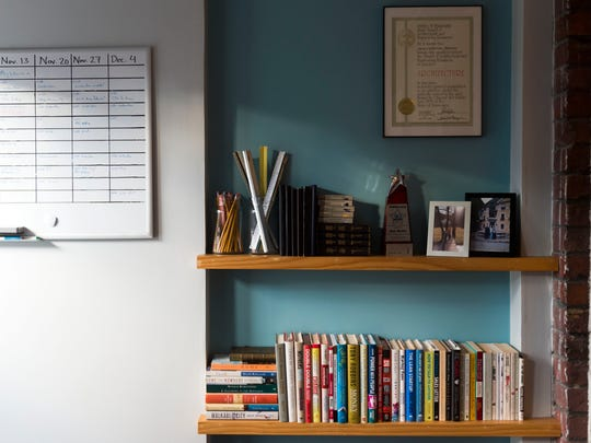 """Books and a to-do list in the """"World Headquarters of"""