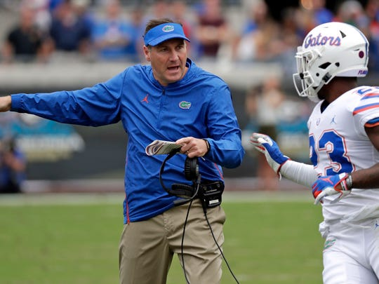 FILE - In this Oct. 27, 2018, file photo, Florida head coach Dan Mullen, left, talks with defensive back Chauncey Gardner-Johnson during the first half of an NCAA college football game in Jacksonville, Fla. Mullen is navigating a few last-minute roster tweaks before the season opener. (AP Photo/John Raoux, File)