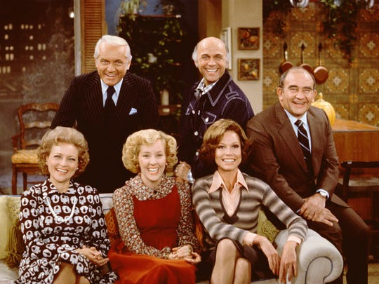 "The cast poses for a publicity portrait on the set of ""Mary Tyler Moore,"" in Los Angeles on November 21, 1975: Left to right: Betty White, Ted Knight, Georgia Engel, Gavin McLeod,Mary Tyler Moore, and Ed Asner."