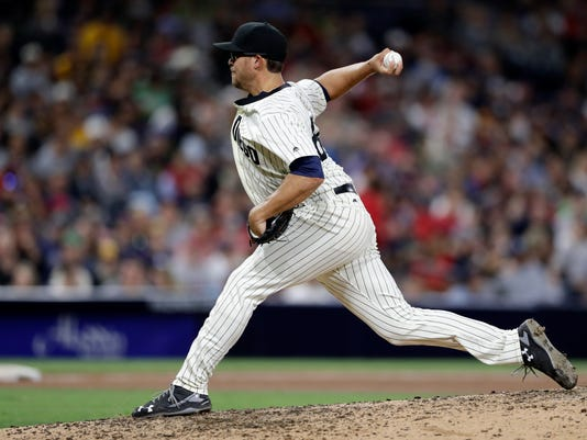San Diego Padres pitcher Jake Smith throws the first pitch of his major league debut, which was hit by Boston Red Sox's Hanley Ramirez for a home run during the eighth inning of a baseball game Wednesday, Sept. 7, 2016, in San Diego. (AP Photo/Gregory Bull)
