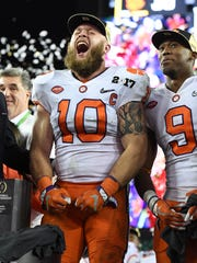 Clemson linebacker Ben Boulware (10) celebrates after the Tigers defeated Alabama 35-31 to win the National Championship at Raymond James Stadium in Tampa on Monday, January 9, 2017.