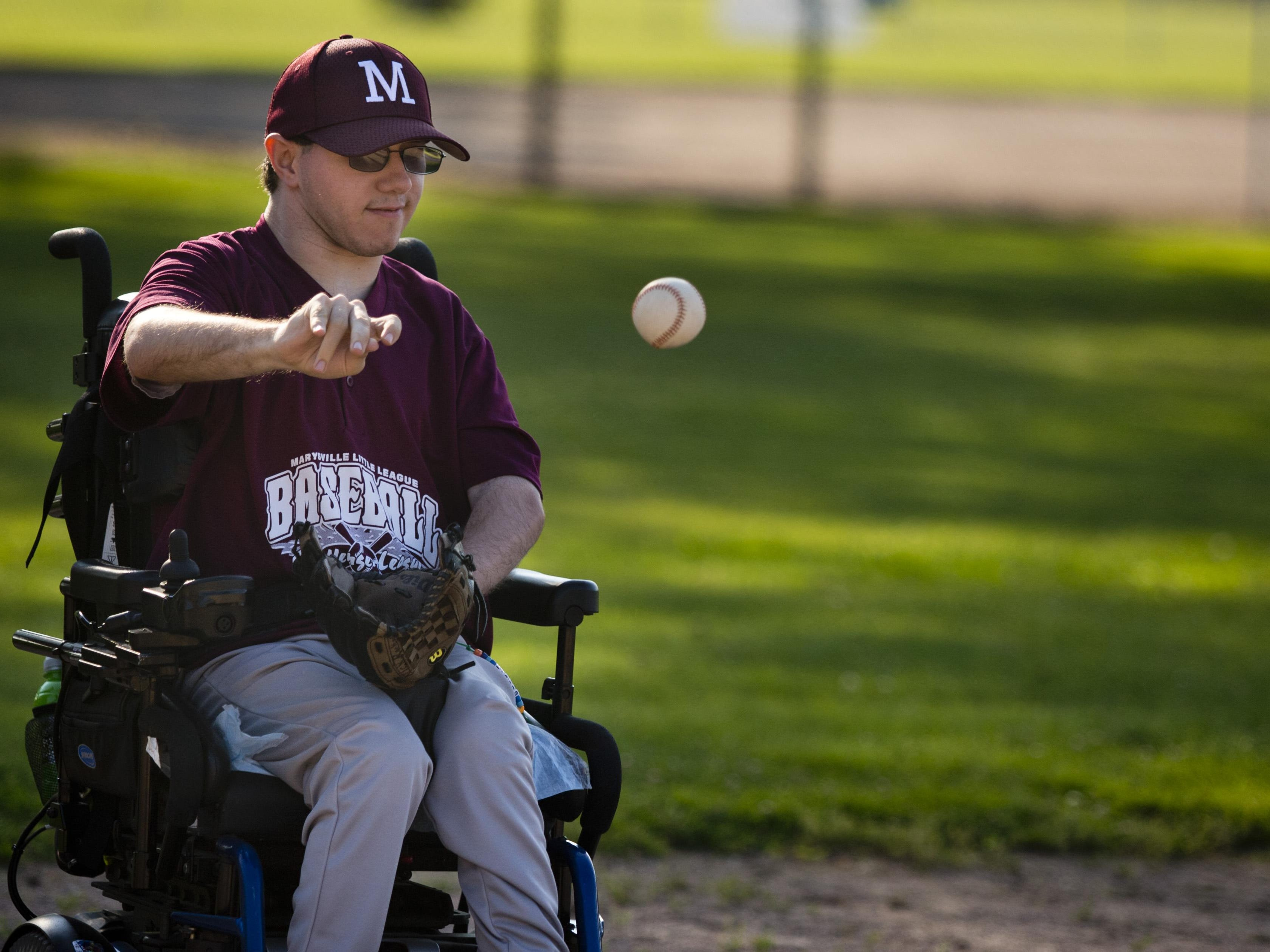 Nick Rockwell, 20, of Clyde Township, throws the ball during a Marysville Little League Challenger Division baseball game Thursday, July 2, 2015 at Marysville Municipal Park.