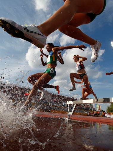A general view as competitors navigate the water jump in the women's athletics 3000m steeplechase final during the 2015 Pan Am Games at CIBC Pan Am Athletics Stadium. Mandatory Credit: Rob Schumacher-USA TODAY Sports