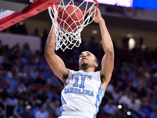Mar 19, 2016; Raleigh, NC, USA; North Carolina Tar Heels forward Brice Johnson (11) dunks the ball against the Providence Friars in the second half during the second round of the 2016 NCAA Tournament at PNC Arena. Mandatory Credit: Bob Donnan-USA TODAY Sports