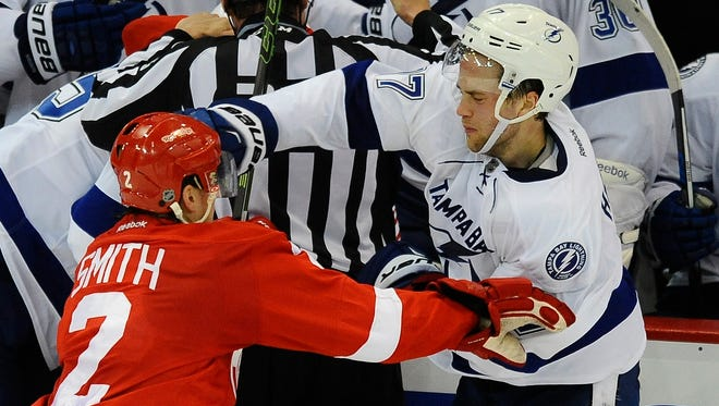 Wings Brendan Smith gets hit with a punch by Lightning's Victor Hedman as the third period ends and the scrum begins.