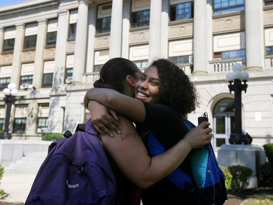 De'Jia Dawkins, 14, hugs her mother, Christy Bruno, after her first day of school at Asbury Park High School and the Dream Academy program in Asbury Park, NJ Thursday September 8, 2016