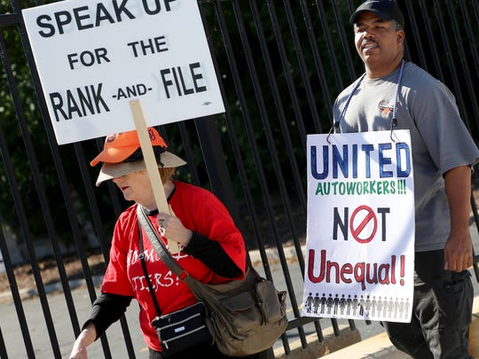Judy Wraight, 68, a retired Ford worker, protested to support her brothers and sisters, along with Tony Stephens, 46, of Belleville, a current Ford worker. They wanted to send a message to their representatives to negotiate a fair contract during a protest outside the UAW headquarters in Detroit on Wed., Sept. 23, 2015.
