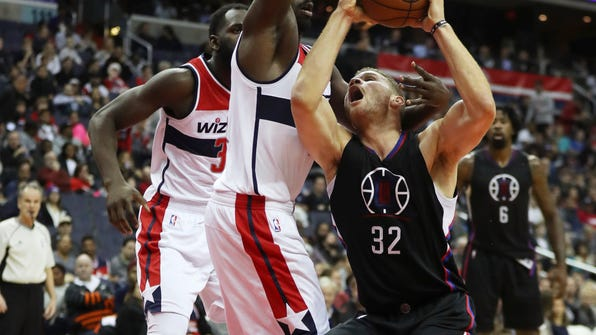 Los Angeles Clippers forward Blake Griffin (32) attempts to shoot against Washington Wizards forward Andrew Nicholson (44) during the first half of an NBA basketball game in Washington, Sunday, Dec. 18, 2016. (AP Photo/Manuel Balce Ceneta)