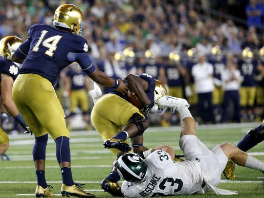 "Michigan State linebacker Jon Reschke tackles Notre Dame running back Josh Adams on Saturday in South Bend, Ind. ""Jon is a versatile player,"" linebackers coach Mark Snyder said this week. ""He's got good speed, good hands, smart player, good guy. That's why he is starting for us."""