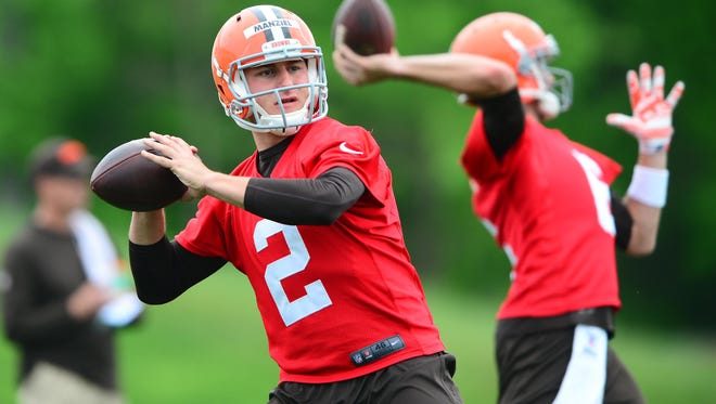 Browns quarterback Johnny Manziel (2) and Brian Hoyer drop back to pass during organized team activities Wednesday at Cleveland Browns training facility.