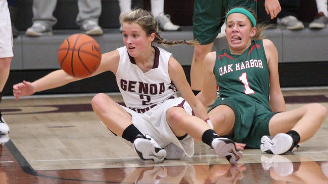 Genoa's Carly Gose and Oak Harbor's Emma Barney battle for the loose ball.