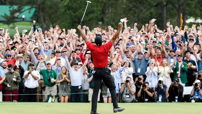 Tiger Woods celebrates winning the 2019 Masters during the final round at Augusta National Golf Club on April 14, 2019, in Augusta.