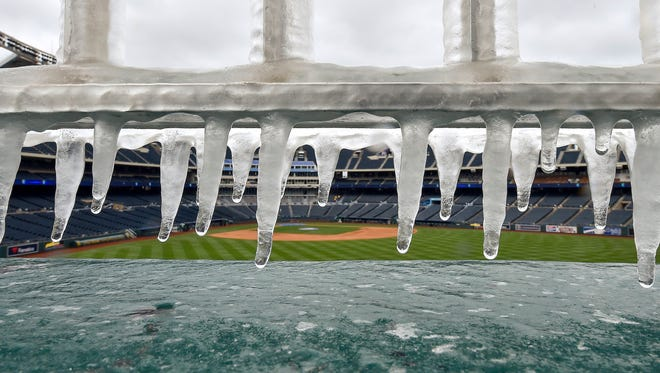 Ice forms on the railing above the fountains Sunday at Kauffman Stadium, where the Royals-Angels game was postponed.