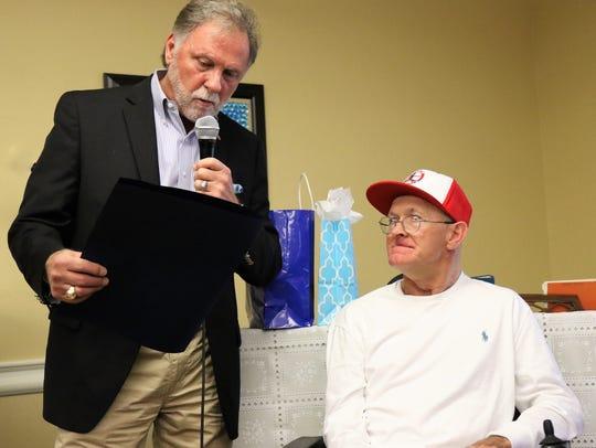 Madison County Mayor Jimmy Harris reads a proclamation