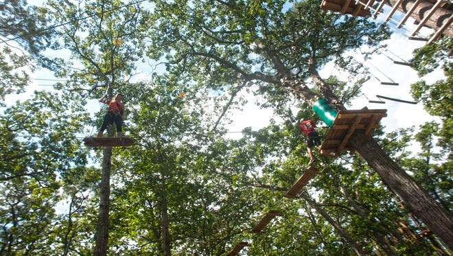 Park Guide Jillian Konschak makes her way through the new zip line course Tree to Tree Adventure Park at Cape May Zoo,