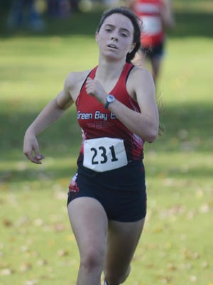 Green Bay East junior Madeline Sweeney finishes fourth place at the WIAA Division 1 Manitowoc sectional cross country meet at Meadow Links Golf Course on Saturday in Manitowoc.