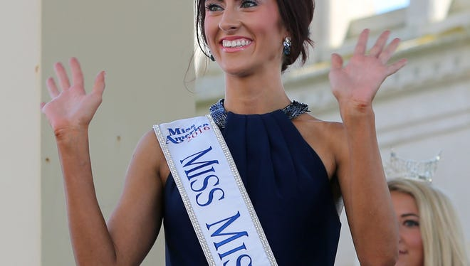 In this Tuesday, Aug. 30, 2016 file photo, Miss Missouri, Erin O'Flaherty waves as she is introduced during Miss America Pageant arrival ceremonies in Atlantic City. After competing in pageants for generations in the closet or working behind the scenes, gays and lesbians finally get to see one of their own take one of pageantry's biggest stages. O' Flaherty, will compete for the Miss America crown on Sept. 11, as the first openly lesbian contestant.
