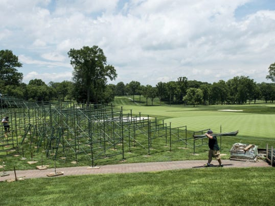 Crews assemble the grandstand behind the 18th green at Lancaster Country Club in preparation for the 2015 U.S. Women's Open, which will be held at the club July 9-12.