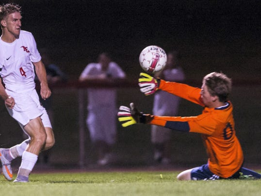 Annville-Cleona senior Matt Light chips the ball past Elco keeper Ethan Krall on an eventual miss wide right. Light and the Little Dutchmen beat the Raiders, 1-0, Wednesday.